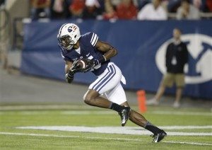 In this Sept. 11, 2014 file photo, Brigham Young defensive back Michael Davis (15) carries the ball in the first quarter during an NCAA college football game against Houston, in Provo, Utah. Davis has been charged with misdemeanor counts of assault and riot after a July dispute over a parking spot. (Associated Press)