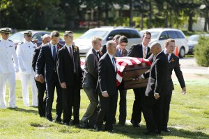 Pallbearers, family of Elder Richard G. Scott, carry his casket for burial. Elder Scott was given military honors by the United States Navy. (Mormon Newsroom)