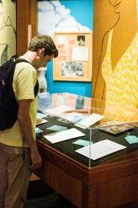 A student looks over artifacts at the Rose Marie Reid exhibit in the L. Tom Perry Special Collections area of the Harold B. Lee Library. Rose Marie was an innovator of swim fashion, even being nominated for Sport's Illustrated Designer of the Year in 1956. (Natalie Bothwell)