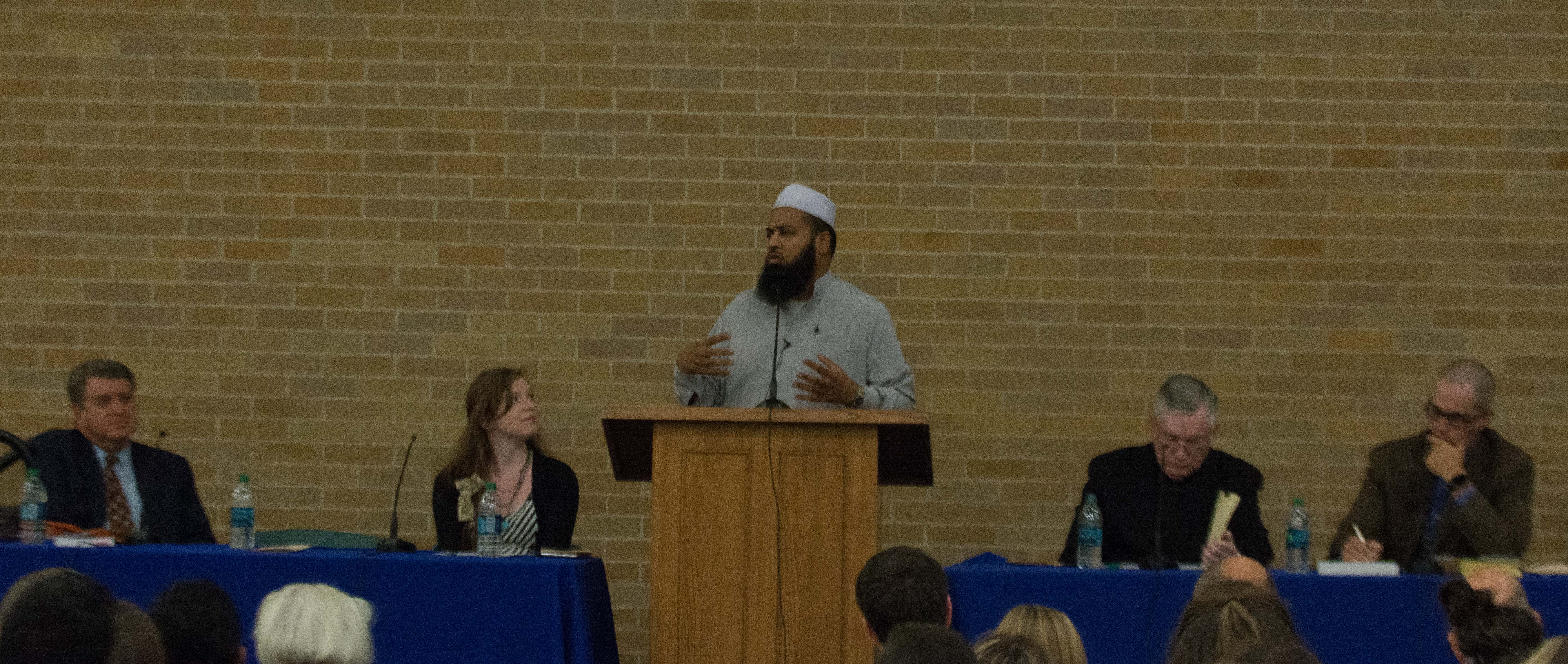 Imam Shuaib-ud Din speaks at the HEaven and Hell Symposium. From left to right: Brent Top, Amber Cazzell Nadal - President of BYU CrossSeekers, Imam Shuaib-ud Din, Monsignor M. Francis Mannion, Travis Kerns. (Natalie Bothwell)