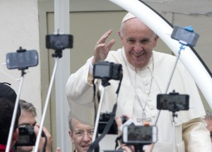 Pope Francis arrives for his weekly general audience in St. Peter's Square at the Vatican, Wednesday, Oct. 28, 2015. (AP Photo/Alessandra Tarantino)
