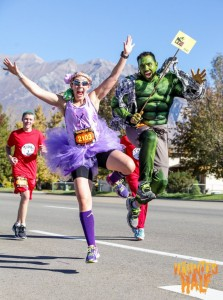 Participants get into the Halloween spirit by dressing up to run the Haunted Half. Supporters can also dress up and cheer on friends and family. (Miguel Guzman)