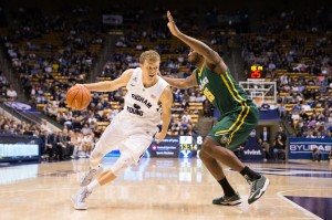 Haws drives by a San Francisco defender in 2014. The Cougars are forced to replace Haws this year. (Universe Archive)