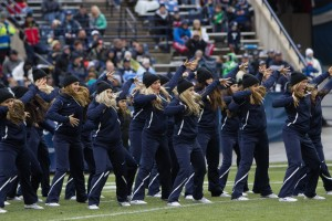 The Courgarettes perform a hip hop routine at a football game. Friday will be their first halftime show in four years. (Universe Archives)