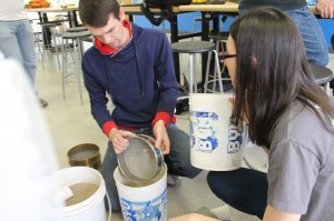 Parker Schnepf and Nichole Martin organize sand by grain size in the GEO lab in the Harvey Fletcher Building on the BYU Campus in Provo, UT. They ensure their filter concepts work before building them in Peru. (Donovan C Baltich)