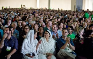 In this photo taken on Thursday, Oct. 15, 2015, people listen as Imam Malik Mujahid, chairman for the Parliament of the World's Religions, speaks during the opening plenary of the 2015 Parliament of the World's Religions held inside the Salt Palace Convention Center in Salt Lake City. Visitors from 80 countries and 50 different religions arrived in Salt Lake City to attend the interfaith conference being held in the United States for the first time since 1993. (Lennis Mahler/The Salt Lake Tribune via AP) DESERET NEWS OUT; LOCAL TELEVISION OUT; MAGS OUT; MANDATORY CREDIT
