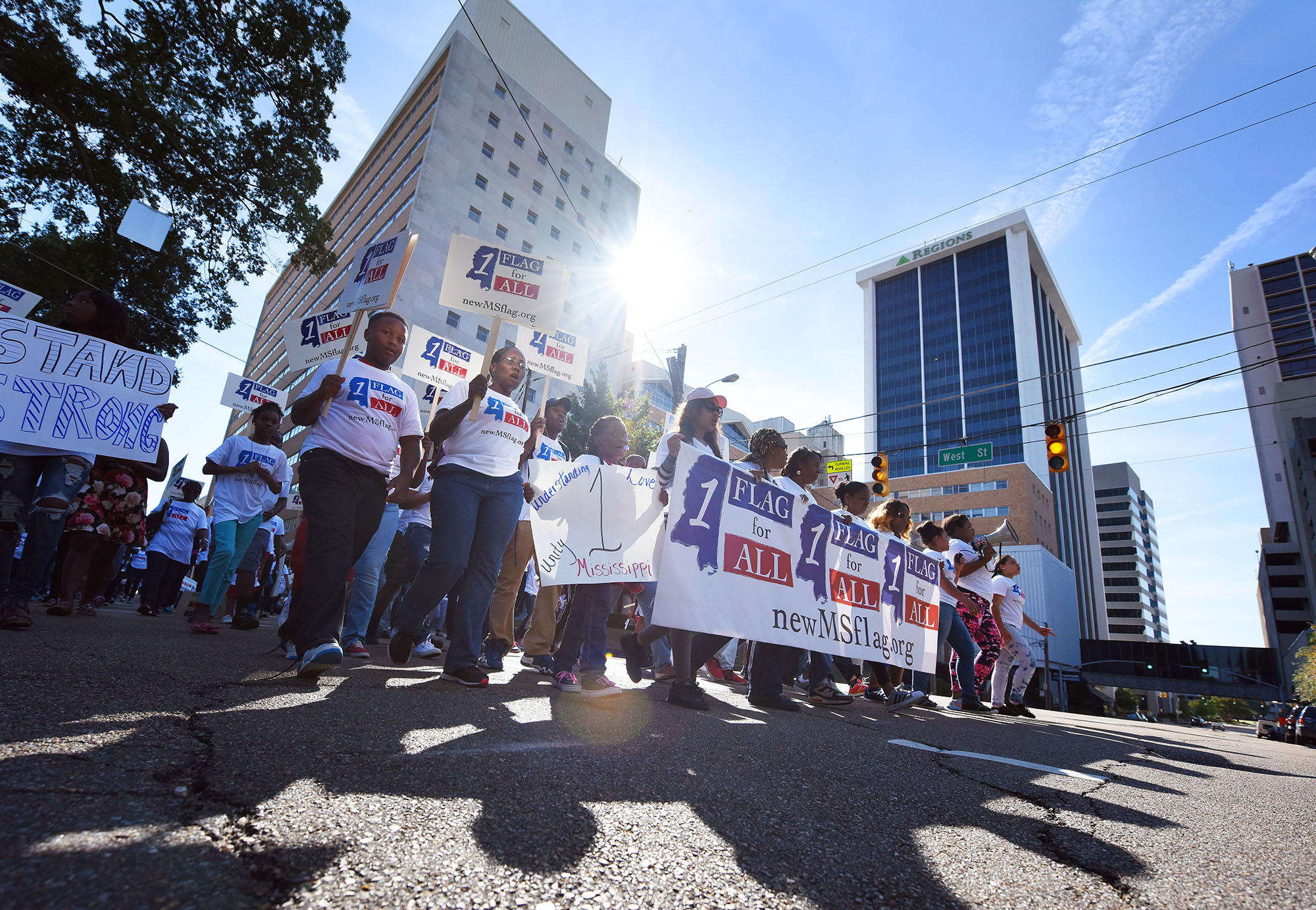 People march in Jackson, Miss., Sunday, Oct. 11, 2015, en route to a change-the-flag rally on the steps of the state Capitol. Civil-rights leader Myrlie Evers-Williams, Mississippi-born rapper David Banner and a prominent South Carolina lawmaker are calling on Mississippi to remove the Confederate battle emblem from its state flag. (Joe Ellis/The Clarion-Ledger via AP) NO SALES; MANDATORY CREDIT
