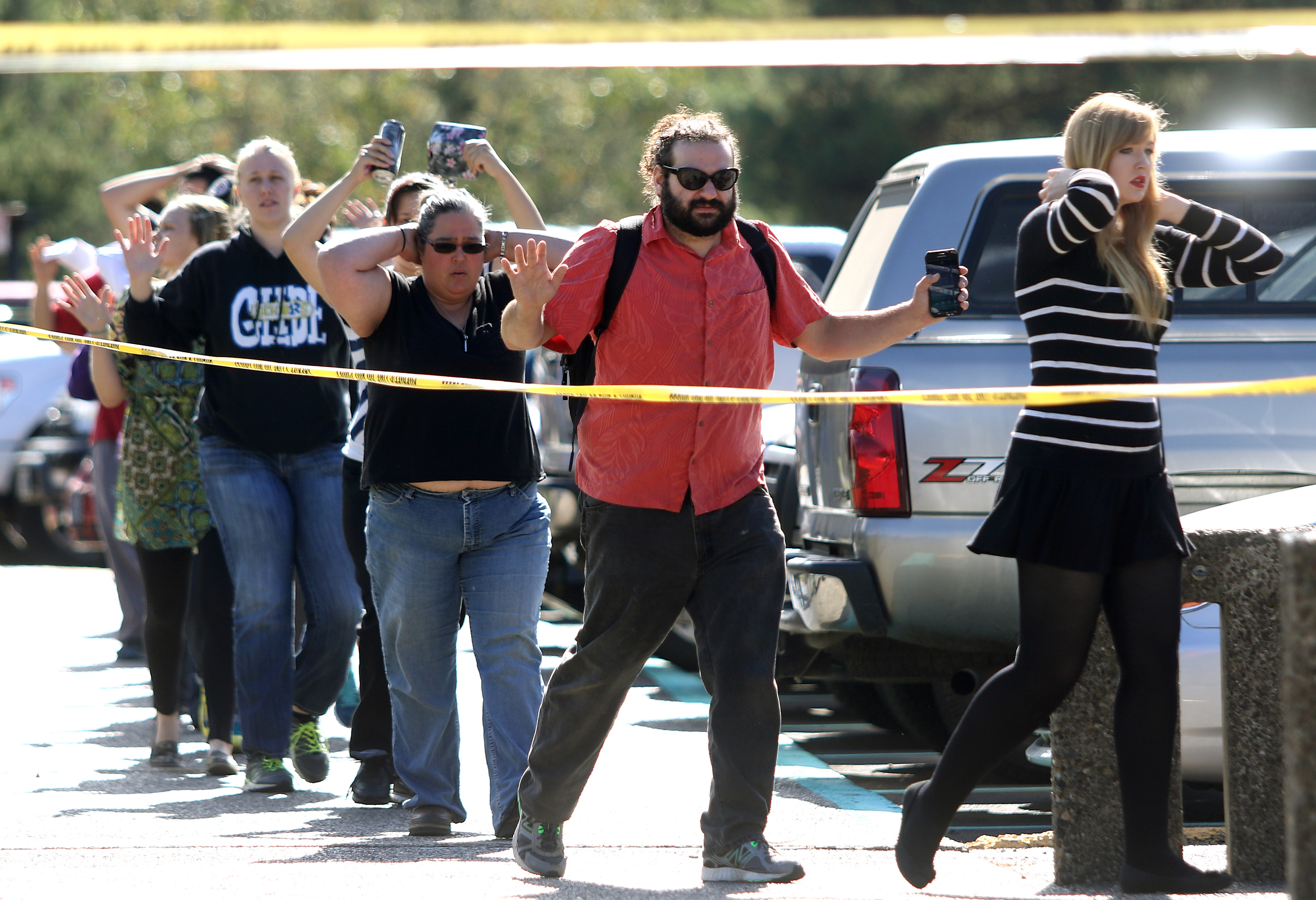 Students, staff and faculty are evacuated from Umpqua Community College in Roseburg, Ore. after a deadly shooting Thursday, Oct. 1, 2015. (Michael Sullivan /The News-Review via AP) MANDATORY CREDIT