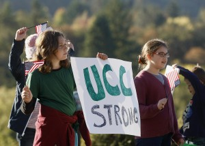 Nari Sarkissin, left, and Penny Lester join hundreds lining the road to Umpqua Community College in Roseburg, Ore., Monday, Oct. 12, 2015, to show support for students returning to school for the first time since the deadliest shooting in state history on Oct. 1. (Mike Henneke/The News-Review via AP, Pool) MANDATORY CREDIT