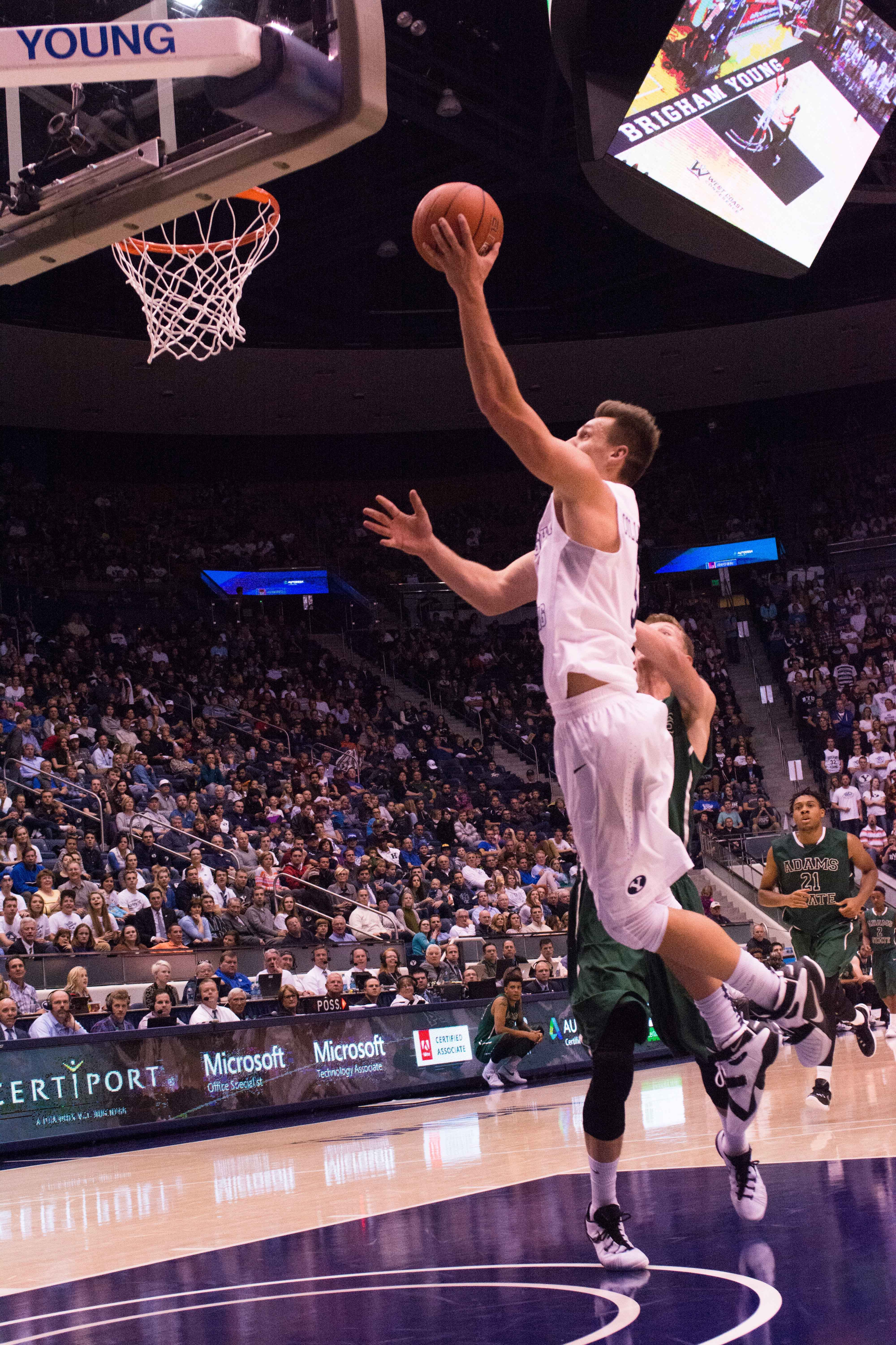 Kyle Collinsworth gets some air against Adams State. Collinsworth now owns the NCAA's single season and career triple-doubles record. (Nathalie Bothwell)