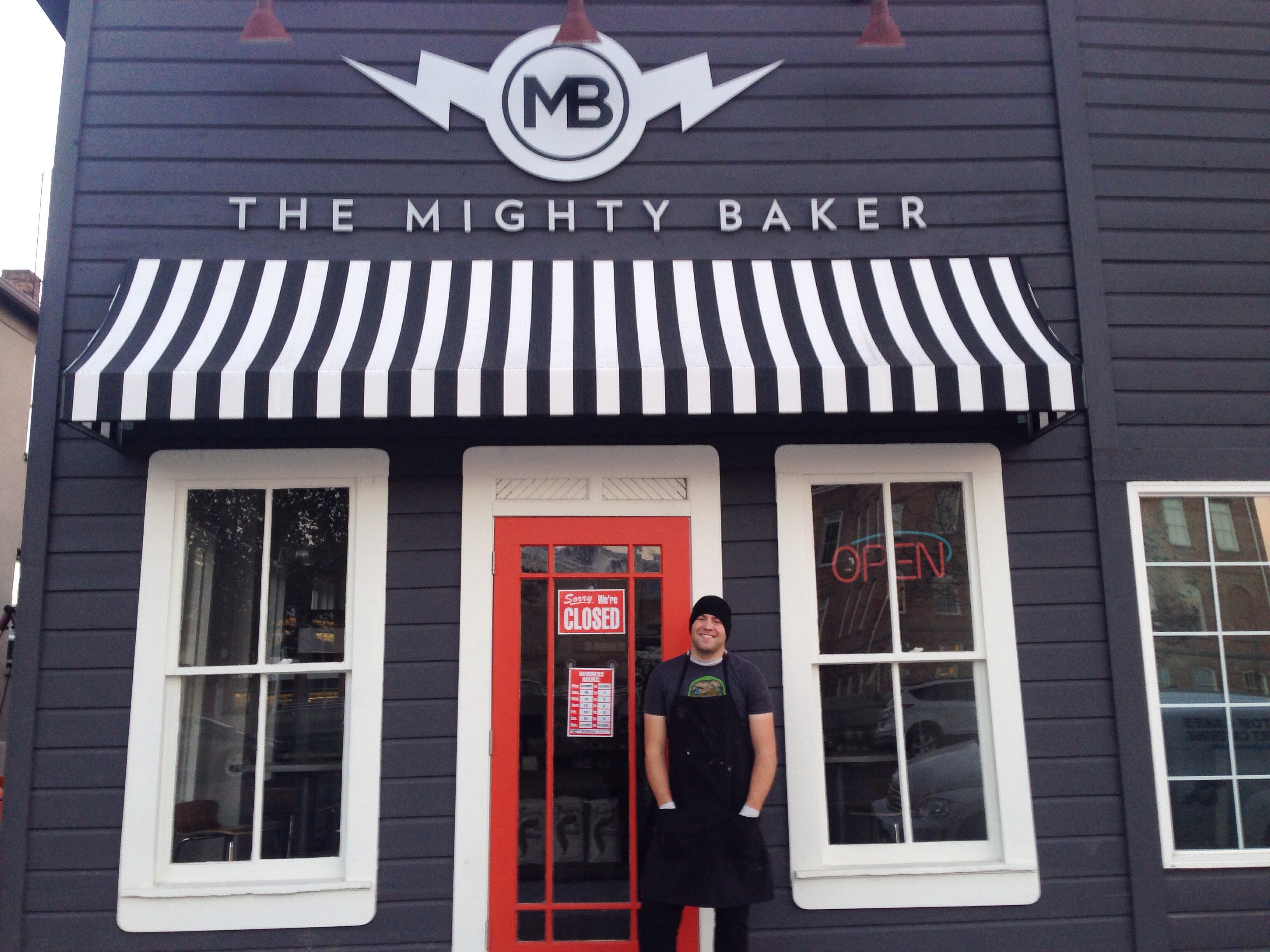 Pete Tidwell stands in front of his new storefront, The