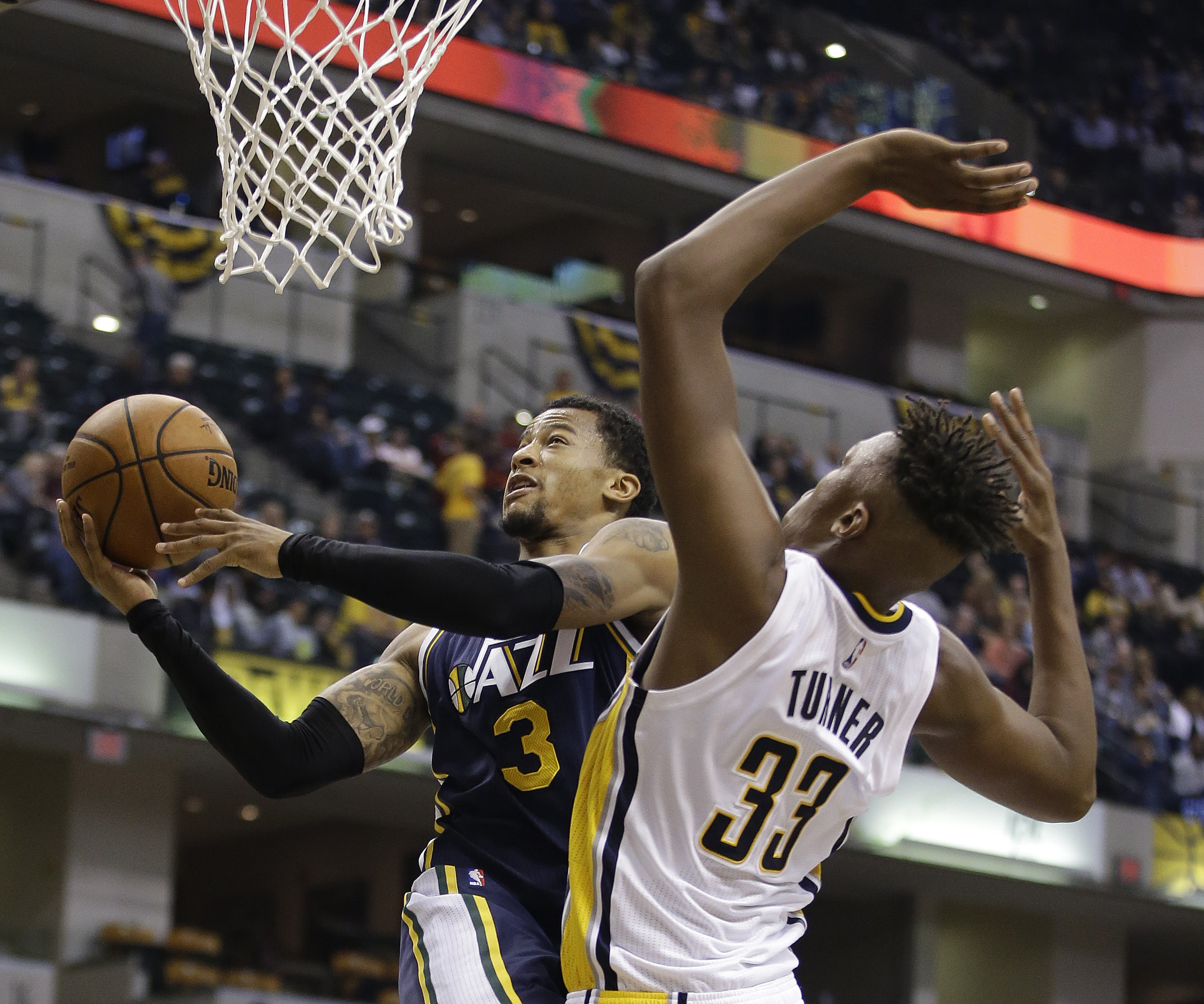 Utah Jazz's Trey Burke shoots against Indiana Pacers' Myles Turner during the second half of the game.  The Jazz beat the Pacers 97-76. (AP Photo/Darron Cummings)