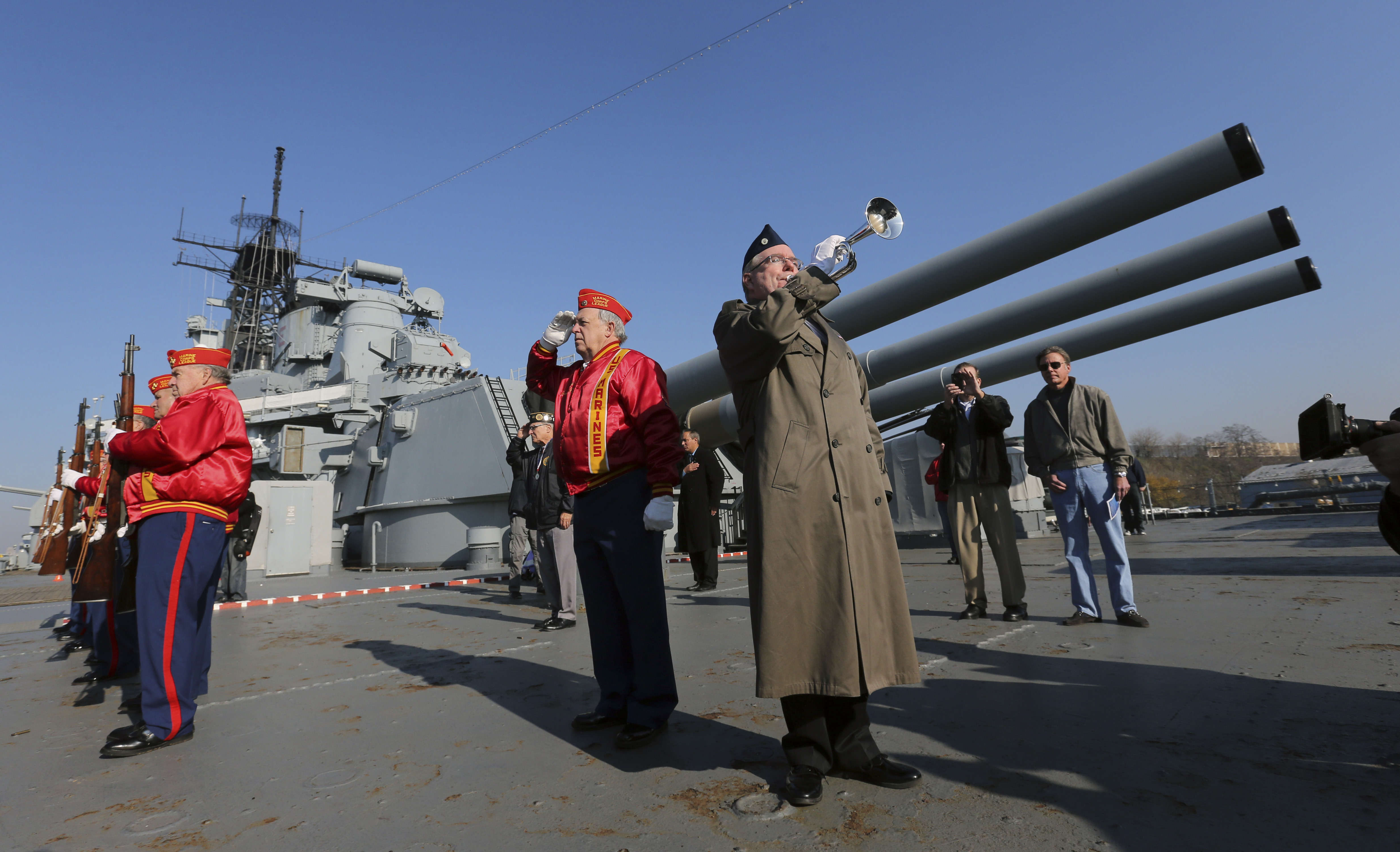 Bugler Greg Murphy plays taps on the battleship New Jersey during a commemoration of the 74th anniversary of the attack on Pearl Harbor, Monday, Dec. 7, 2015, in Camden, N.J. (AP Photo/Mel Evans)