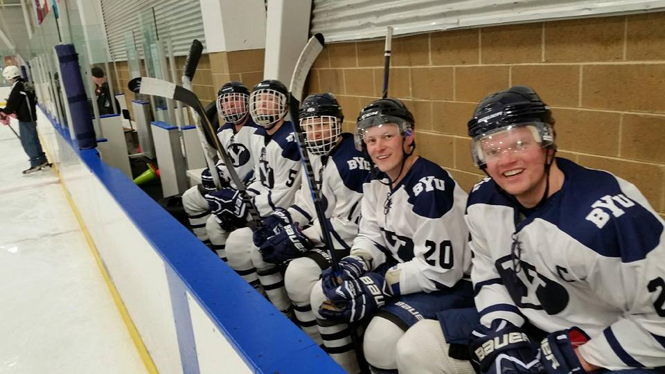 Members of the BYU Hockey team pose on the bench for a photo during a game against the Junior Grizzlies. (Ed Gantt)