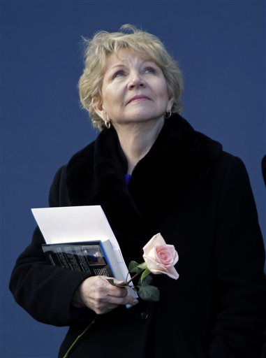 FILE - In this Friday, Jan. 28, 2011 file photo, June Scobee Rodgers, widow of Dick Scobee, commander of space shuttle Challenger, looks upward during the playing of the National Anthem at a remembrance ceremony to mark the 25th anniversary of the Challenger explosion at the Kennedy Space Center visitor complex in Cape Canaveral, Fla., Friday, Jan. 28, 2011. On the 30th anniversary of the space shuttle Challenger accident, June Scobee Rodgers _ widow of Challenger commander Dick Scobee and longtime spokeswoman for the families of the lost astronauts _ is passing the torch to daughter Kathie. (AP Photo/John Raoux)