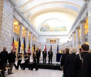 Executive Director Gary Harter, Honorable Ray Mabus, and Governor Gary Herbert place their hand over their heart during the passing of the colors by the US Naval Sea Cadet Corps.
