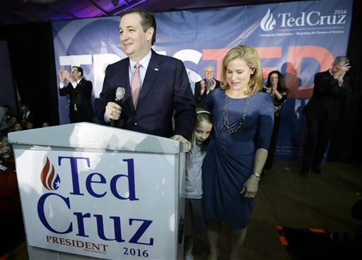 Republican presidential candidate, Sen. Ted Cruz, R-Texas, speaks at caucus night rally with Heidi, and their daughter Caroline, 7, Monday, Feb. 1, 2016, in Des Moines, Iowa. Cruz sealed a victory in the Republican Iowa caucuses, winning on the strength of his relentless campaigning and support from his party's diehard conservatives. (AP Photo/Charlie Neibergall)