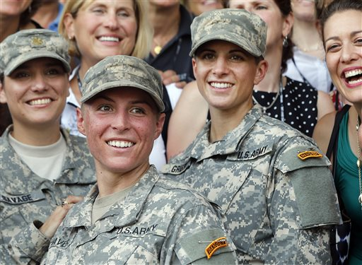 FILE - In this Aug. 21, 2015, file photo, Army 1st Lt. Shaye Haver, center, and Capt. Kristen Griest, right, pose for photos with other female West Point alumni after an Army Ranger school graduation ceremony at Fort Benning, Ga. Haver and Griest became the first female graduates of the Army's rigorous Ranger School. The decision by the Pentagon to allow women to serve in all combat jobs has put new focus on an often-forgotten U.S. institution: the Selective Service. While America has not had a military draft since 1973, all men must register with the Selective Service within 30 days of turning 18. U.S. leaders repeatedly insist that the all-volunteer force is working and the nation is not returning to the draft. But there are increasing rumblings about whether women should now be required to register if they can indeed serve in all areas of the military. (AP Photo/John Bazemore, File)