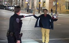 Police stop a boy as he walks away from a crowd that formed after an officer-involved shooting at 200 South Rio Grande Street in Salt Lake City, Saturday, Feb. 27, 2016. Unrest broke out in a Salt Lake City neighborhood on Saturday night after what appears to be a shooting involving a police officer, the Salt Lake Tribune reported. (Lennie Mahler/The Salt Lake Tribune via AP)