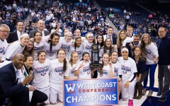 The 2016 WCC Champion BYU Cougars pose with the trophy after defeating San Diego. (Ari Davis)