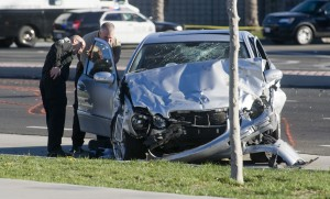 Santa Ana police officers examine one of the cars involved in a collision in Santa Ana, Calif., Monday, Feb. 8, 2016. Orange County authorities said at least one person was seen fleeing the scene of a two-car crash that killed a man and injured two other people. (Sam Gangwer/The Orange County Register via AP) MANDATORY CREDIT