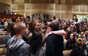 Members of the community pray before the start of the Kalamazoo Community Prayer Service at Centerpoint Church on in Kalamazoo, Mich., Sunday, Feb 21, 2016. A gunman who seemed to choose his victims at random opened fire Saturday outside an apartment complex, a car dealership and a restaurant in Michigan, killing six people in a rampage that lasted nearly seven hours, police said. (Andraya Croft/Detroit Free Press via AP)