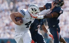 Taysom Hill stiff-arms a Virginia defender in 2014. Hill is returning to BYU for a fifth-year. (Universe Archives)