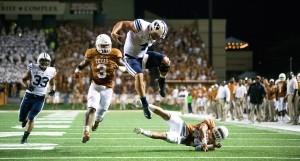 Taysom Hill hurdling a Texas defender in 2014. (BYU Photo)