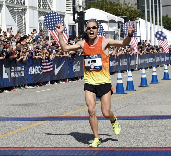 Jared Ward finishing the LA Marathon. Ward came in third place and qualified for the Olympics. (Twitter/@TaFphoto)