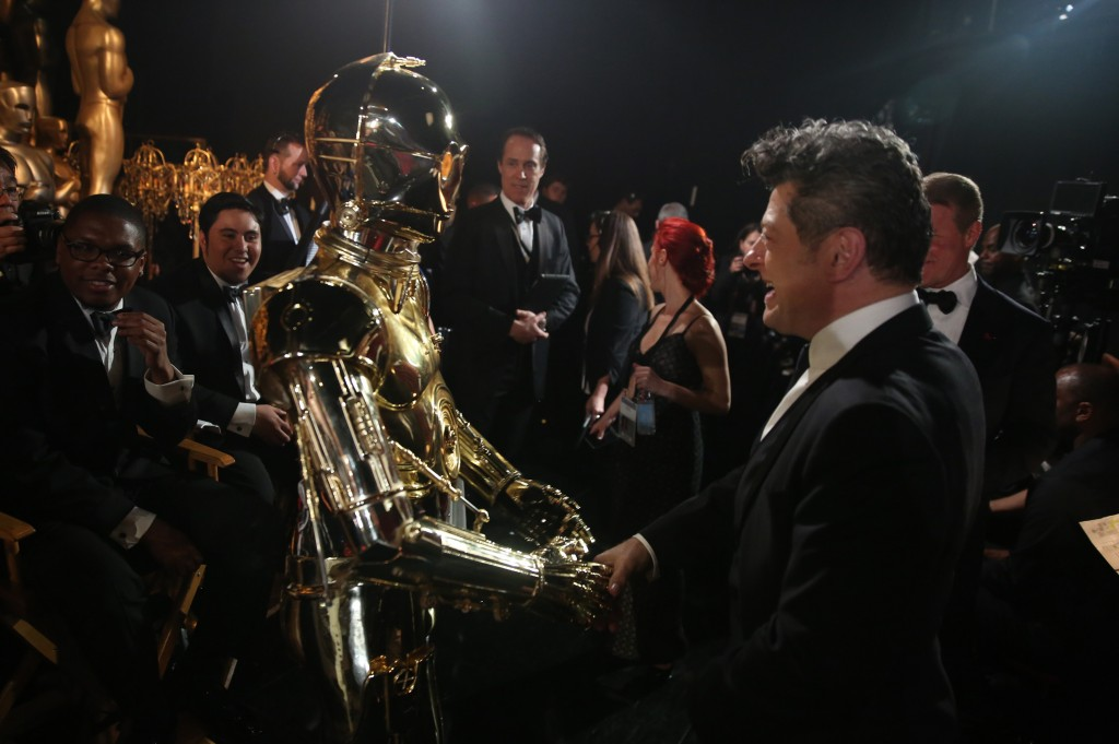 """""""Star Wars"""" character C-3PO, left, appears backstage with Andy Serkis at the Oscars on Sunday, Feb. 28, 2016, at the Dolby Theatre in Los Angeles. (Photo by Matt Sayles/Invision/AP)"""