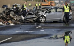 California Highway Patrol officers investigate a fiery crash late Friday night, involving multiple vehicles on Saturday, Feb. 27, 2016 in Commerce, Calif. The California Highway Patrol reports the crash happened in Commerce, about 8 miles east of downtown Los Angeles. According to authorities, the drivers of two Dodge vehicles were racing when one of the cars tried to get around a slower vehicle on the highway. The driver slammed on the brakes and hit a UPS truck. (Irfan Khan/Los Angeles Times via AP) NO FORNS; NO SALES; MAGS OUT; ORANGE COUNTY REGISTER OUT; LOS ANGELES DAILY NEWS OUT; INLAND VALLEY DAILY BULLETIN OUT; MANDATORY CREDIT, TV OUT