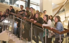 Many students gathered on the stairs to observe the student exhibitions at the Night at the HFAC. (Natalie Stoker Photos)