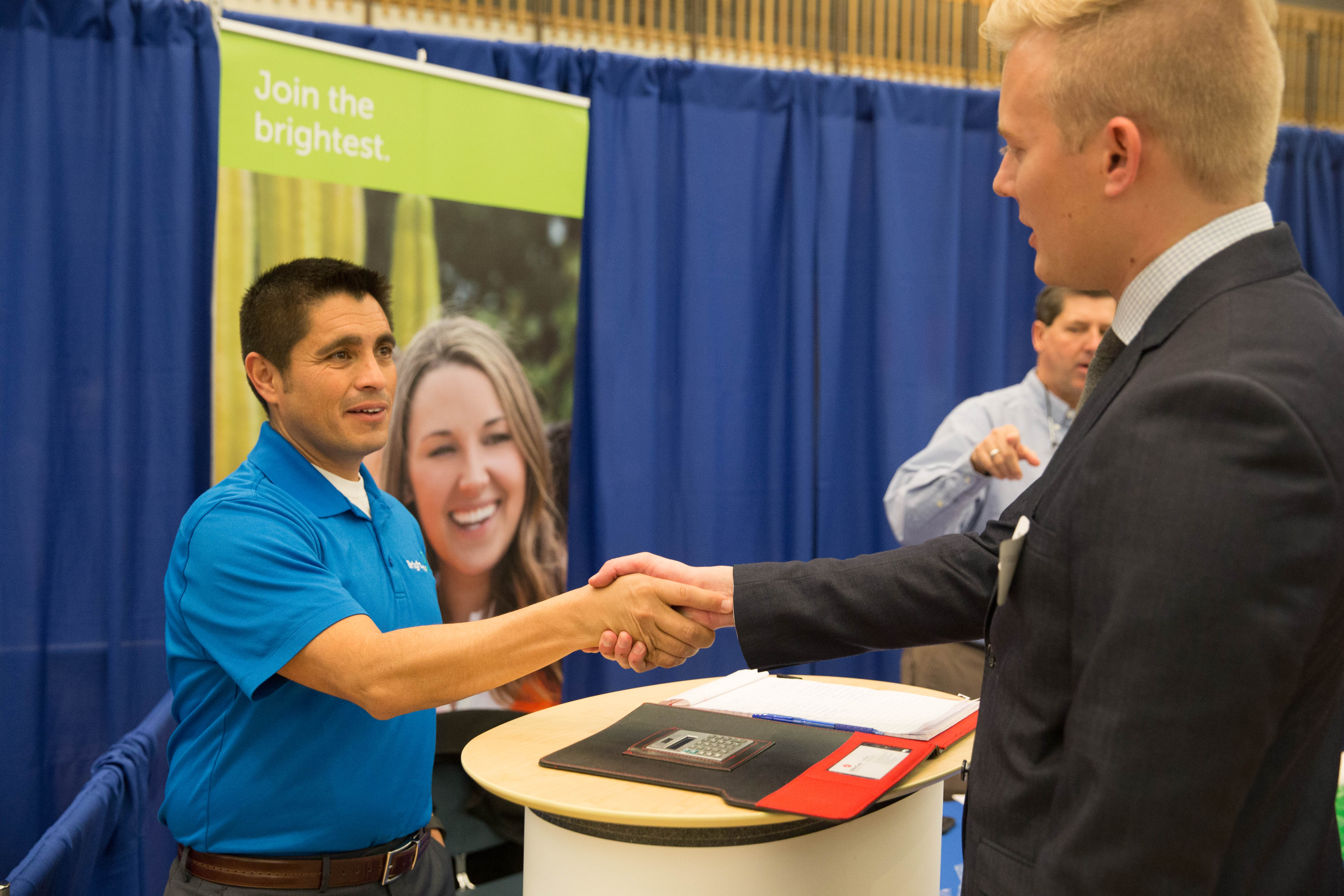 networking helps byu students transition from college to career a recruiter talks to a byu student at a career fair natalie stoker