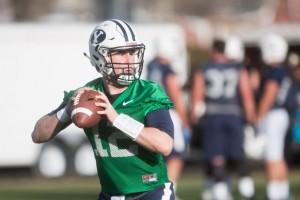 BYU quarterback Tanner Mangum throws the ball during practice on Thursday. (Ari Davis)