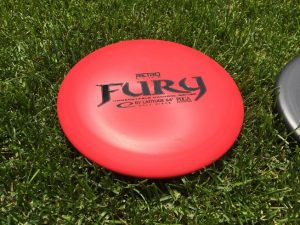 A Professional Disc Golf Association approved disc. Discs vary in thickness for different distance of throws. (Gavin Fowler)