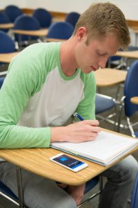 BYU junior Zach Herlin uses Pocket Points while studying on campus. Students use similar apps to stop wasting time online. (Natalie Saunders)