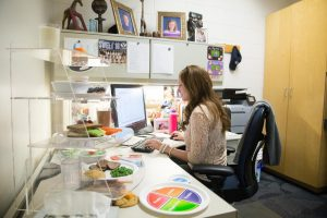 BYU dietician and nutritionist Rachel Higginson works in her office. Higginson has helped a number of athletes overcome eating disorders. (Maddi Driggs)