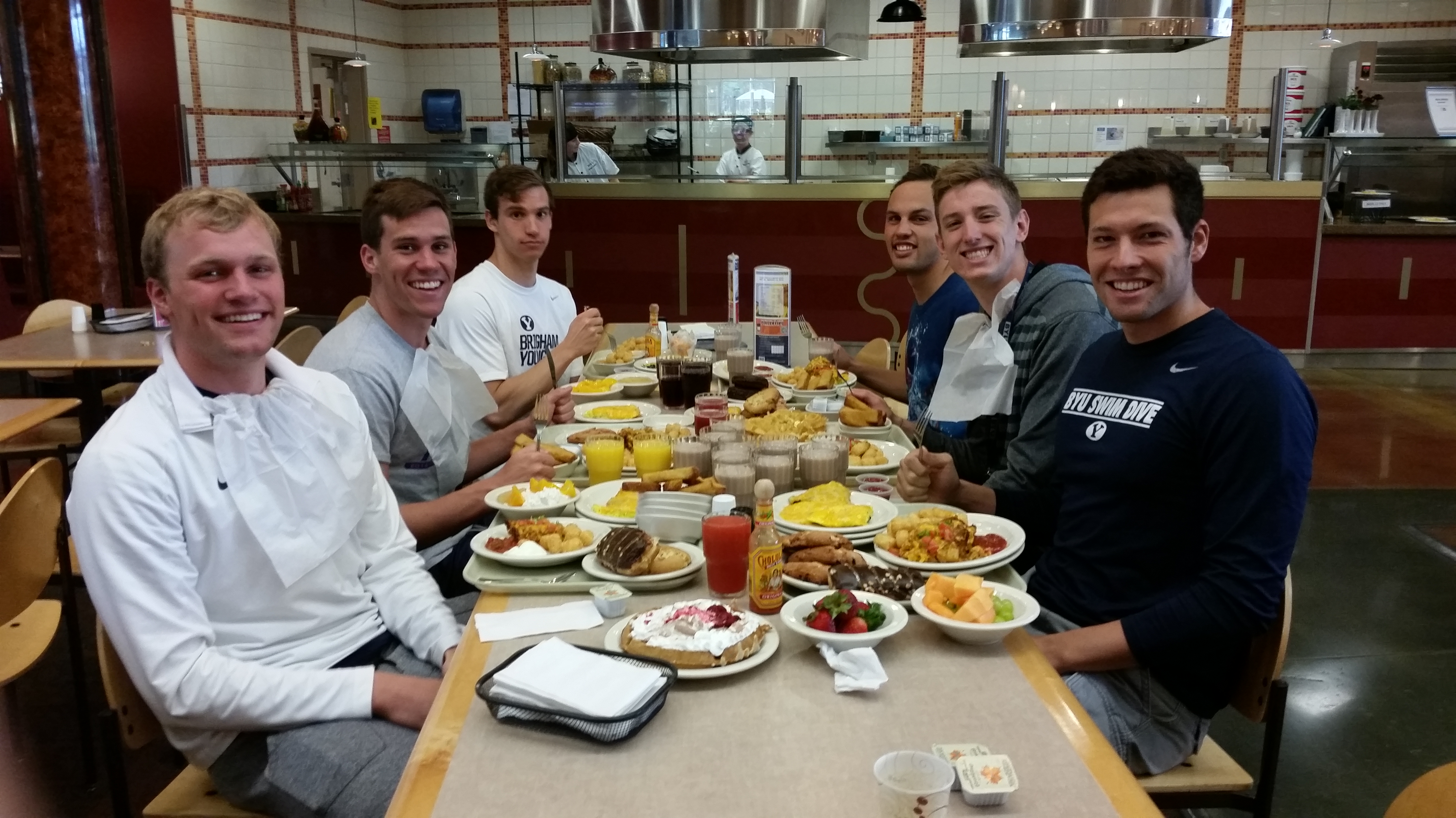 BYU Men's swim team eats at the Cannon Center after practice. The swim team eats 10,000 calories a day while in training. (Photo by Jake Taylor)