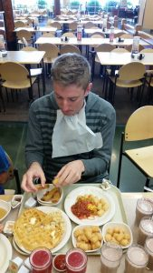 Freshman swimmer Conner Stirling eats at the Cannon Center after a practice. (Photo by Jake Taylor)