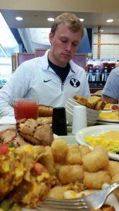 Swim team member Kent Fellows eats a huge breakfast after practice.