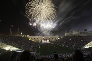 Audience members watch the evening firework show during the 2014 Stadium of Fire program at Lavell Edwards Stadium. (Elliott Miller)