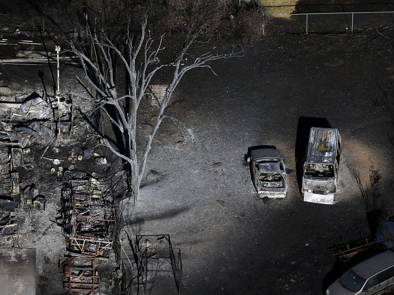 Burnt vehicles and charred debris remain following a fire in Tooele, Utah on Wednesday, July 20, 2016. Firefighters contained a blaze fueled by wind that ripped through a Utah trailer park, displacing dozens of people and destroying multiple homes. (Ravell Call/The Deseret News via AP)