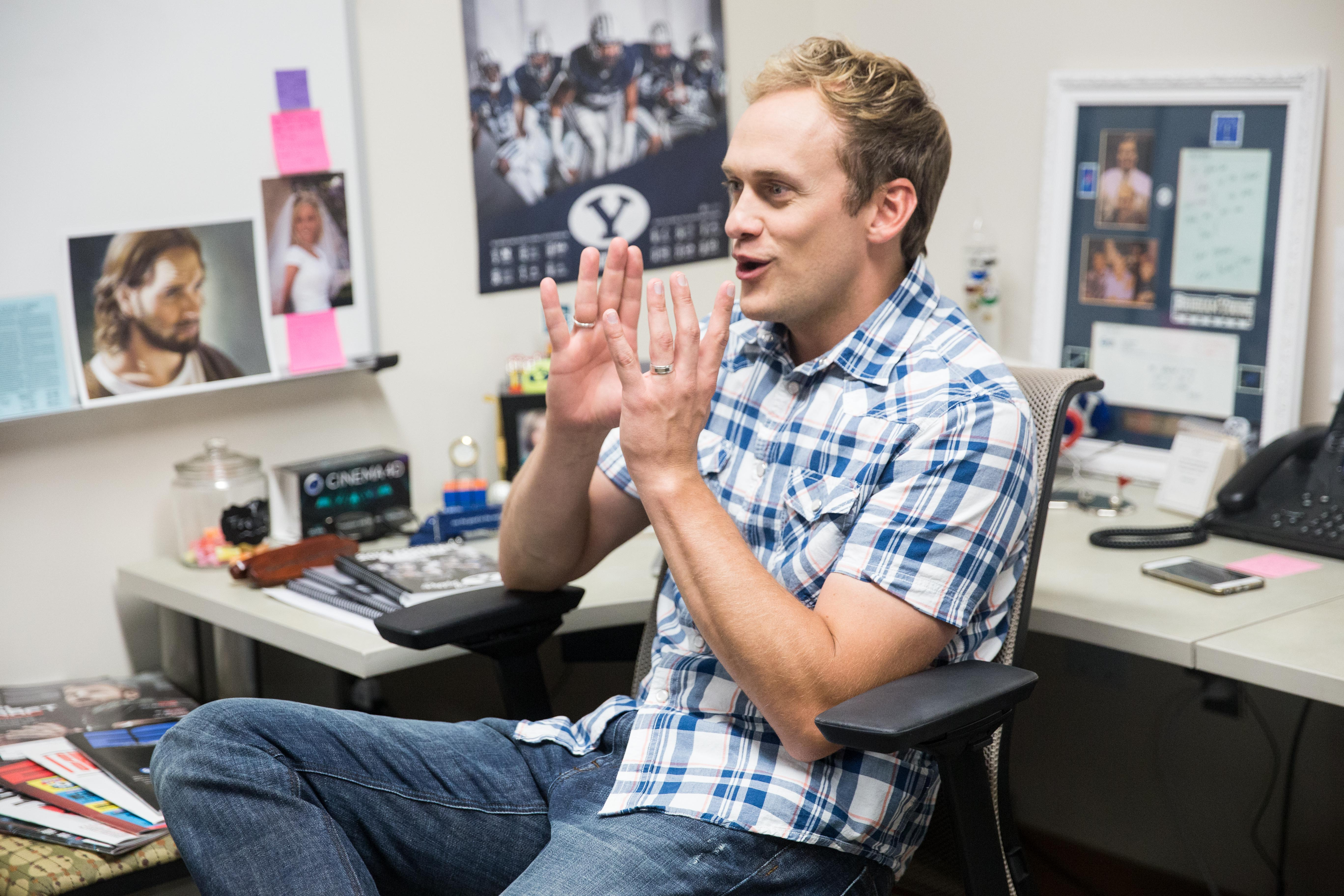 Spencer Linton speaks in his office in the BYU broadcasting building. Linton is a co-host of BYU Sports Nation with Jarom Jordan. (Maddi Driggs)