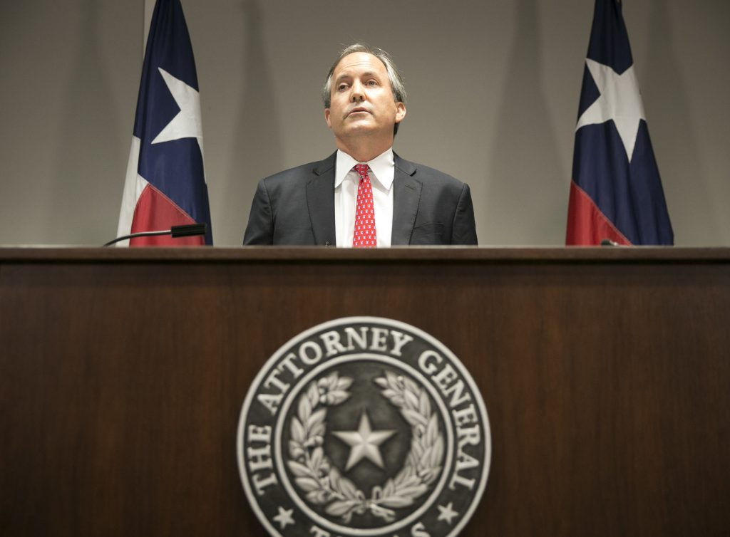 FILE - In this May 25, 2016, file photo, Republican Texas Attorney General Ken Paxton announces Texas' lawsuit to challenge President Obama's transgender bathroom order during a news conference in Austin, Texas. A federal judge in Texas is blocking for now the Obama administration's directive to U.S. public schools that transgender students must be allowed to use the bathrooms and locker rooms consistent with their chosen gender identity. Paxton had argued that halting the law before school began was necessary because districts risked losing federal education dollars if they didn't comply. (Jay Janner/Austin American-Statesman via AP)