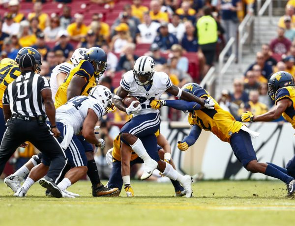 BYU running back Jamaal Williams carries the ball against West Virginia. Williams set BYU's single game rushing record against Toledo.  (BYU Photo)