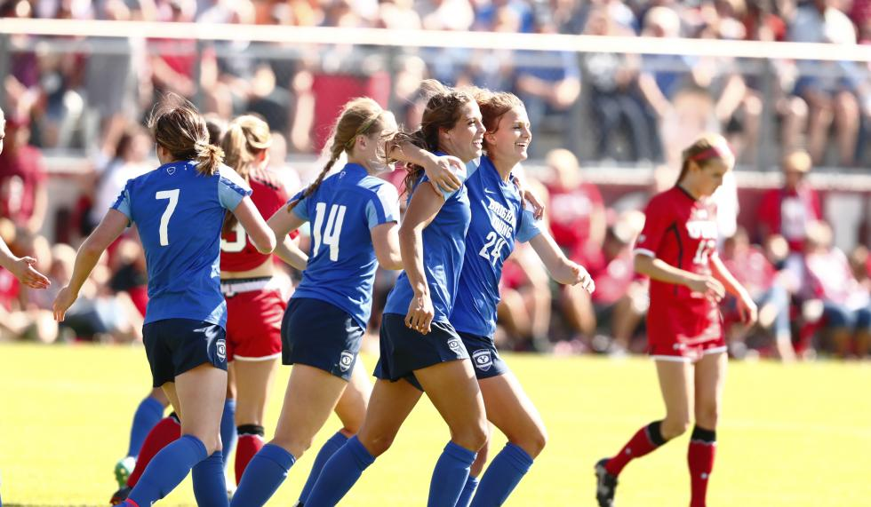 The BYU women's soccer team celebrates after scoring a goal against Utah. BYU won the game 2-0. (BYU Photo)