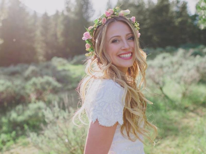 McKinely Haas poses for a bridal photo. Haas is wearing subtle makeup in natural colors.