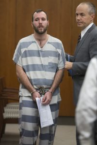 Dereck James Harrison, left, stands beside his attorney Michael Edwards in a courtroom on Monday, Oct. 24, 2016, in Farmington, Utah. Harrison, who pleaded guilty to tying up five people in a basement, was sentenced to serve at least 30 years up to life in prison, but first he'll face murder charges in Wyoming connected to the same crime spree. Harrison is expected to be extradited shortly after his sentencing Monday in Utah. (Briana Scroggins/Utah Standard-Examiner via AP, Pool)
