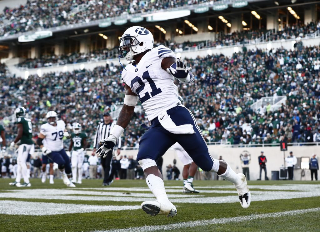 Jamaal Williams celebrates after scoring a touchdown against Michigan State. (BYU Photo)