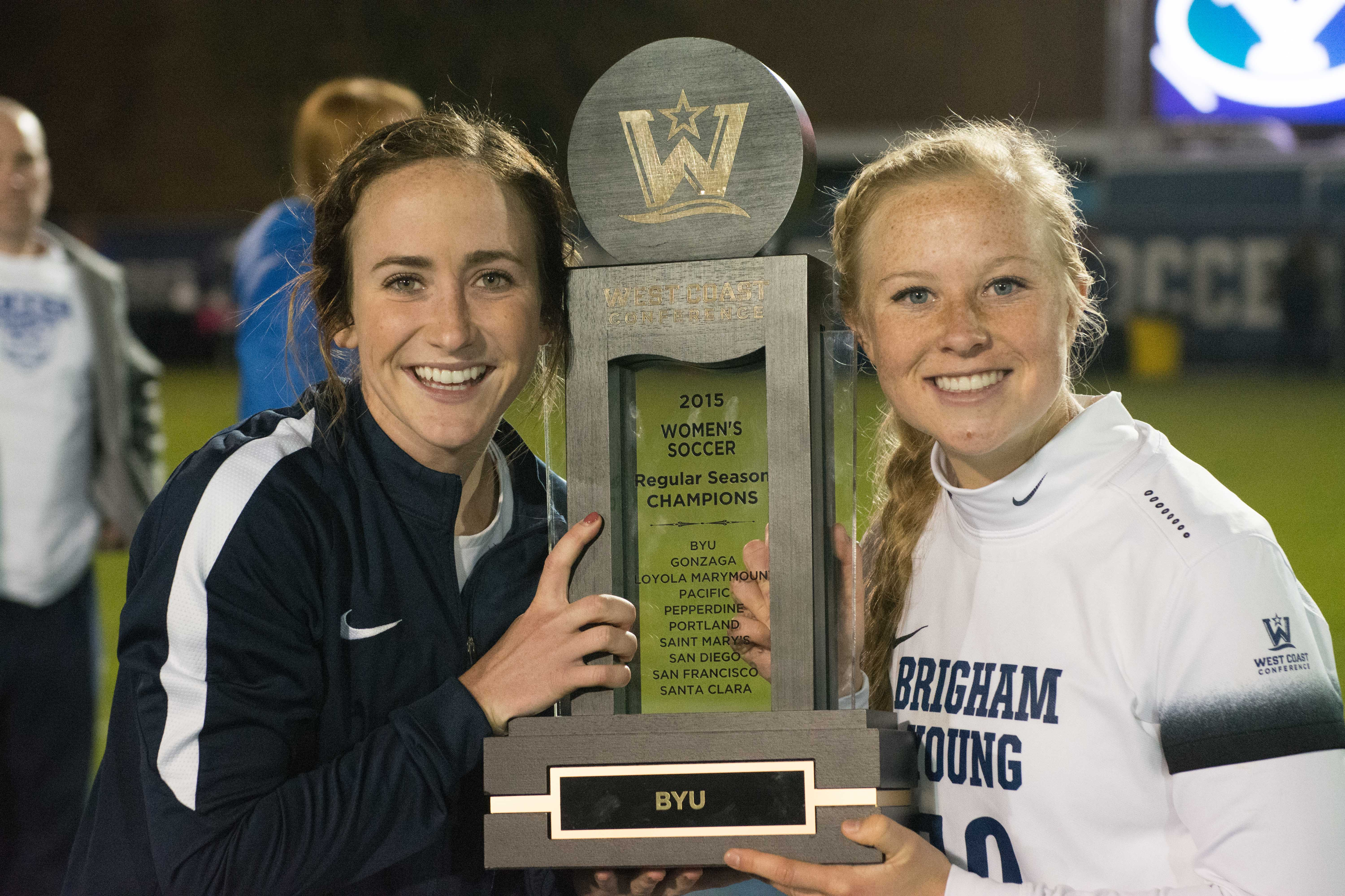 Michele Vasconcelos and Bizzy Bowen pose with the West Coast Conference championship. Vasconcelos and Bowen are best friends. (Ryan Turner)